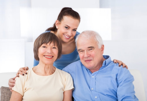 elderly couple and caregiver